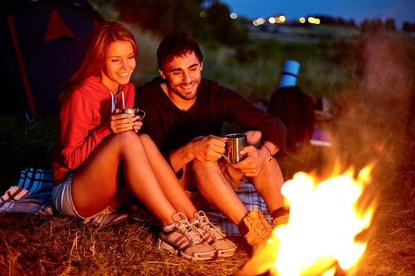 couple sitting around firepit