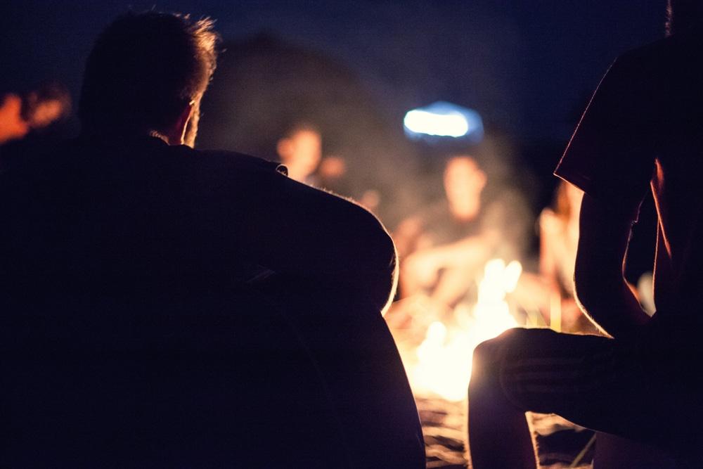 Friends enjoying a fire pit in NSW backyard