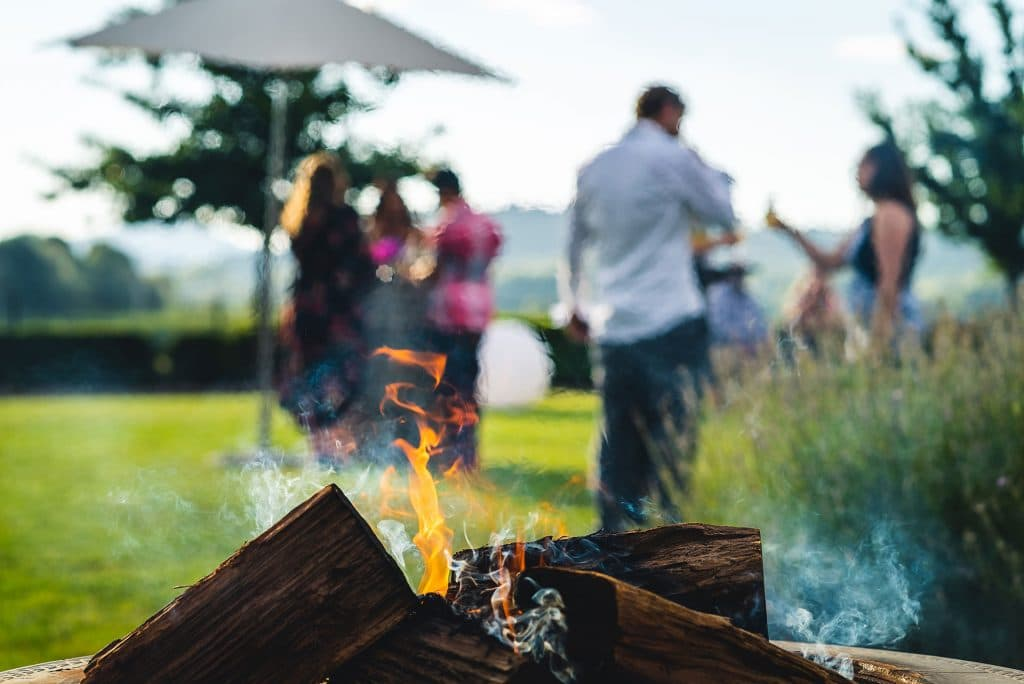 photo of people using fire pit accessories